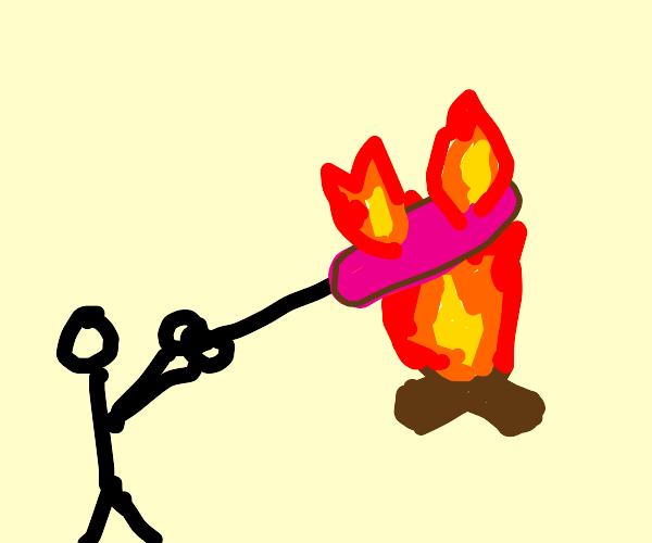 man burns giant hot dog