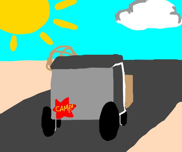 Camper van driving on empty road