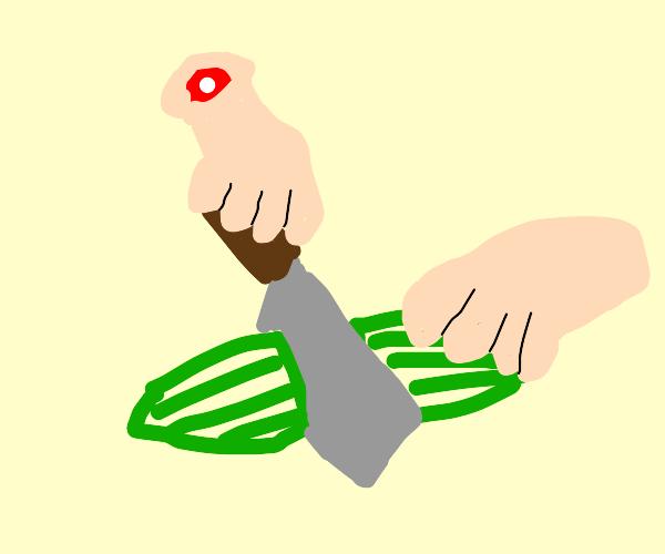 Disembodied hands cutting a cucumber