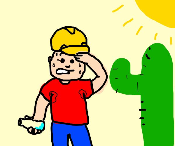 Man wearing a helmet and cactus in hot desert