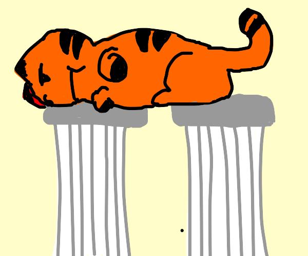 giant garfield sleeps on two pillars