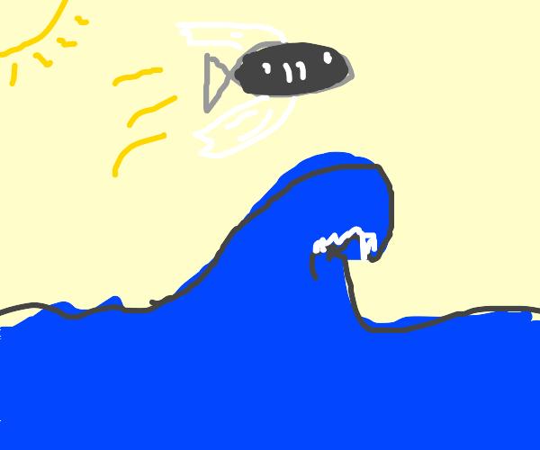 fish flies over ocean
