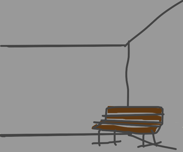 Brown bench in a corner of a gray room