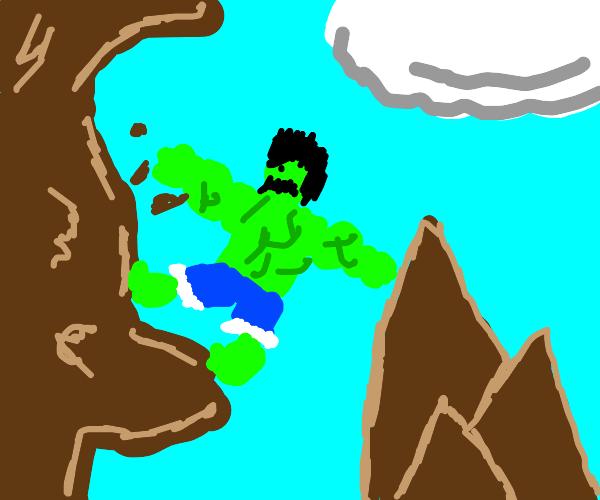 the hulk struggles to climb a rock wall