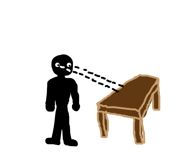 Black man looks at a Table