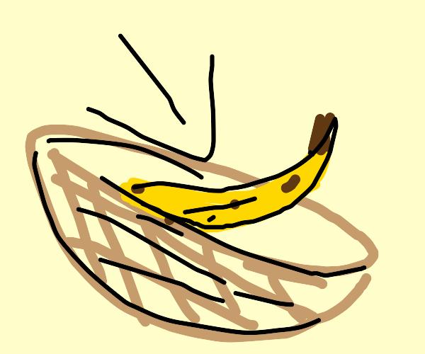 A single banana in a fruit bowl