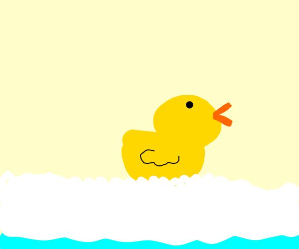Happy rubber duck in a foam bath