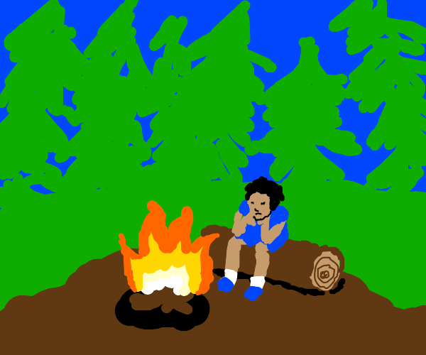 Sitting near to a campfire feeling sad