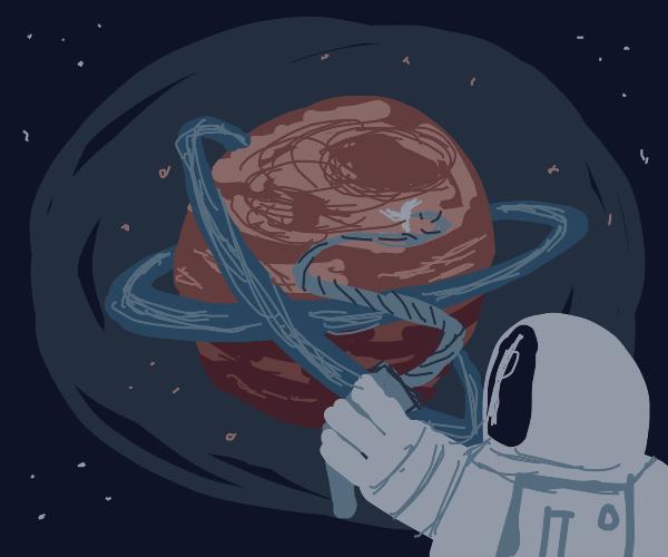 Astronaut grapples onto gas giant