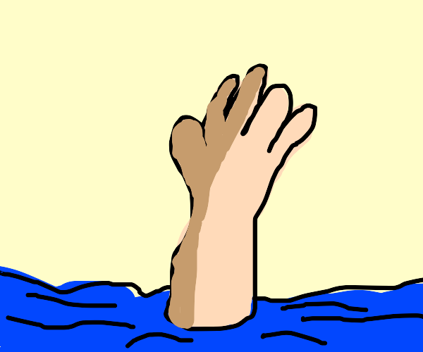 Hand sinking into the ocean