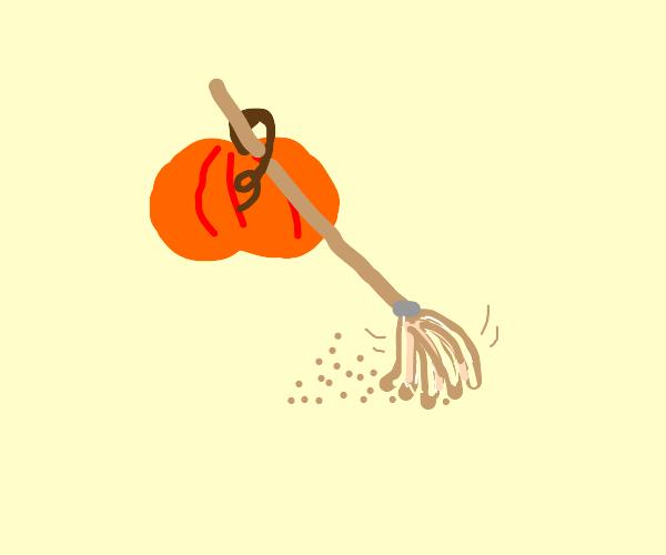 Pumpkin sweeping the floor