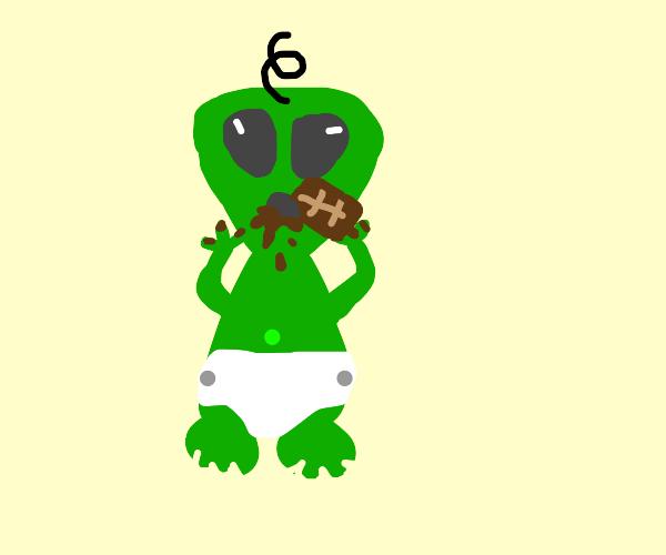 baby alien eating chocolate bar