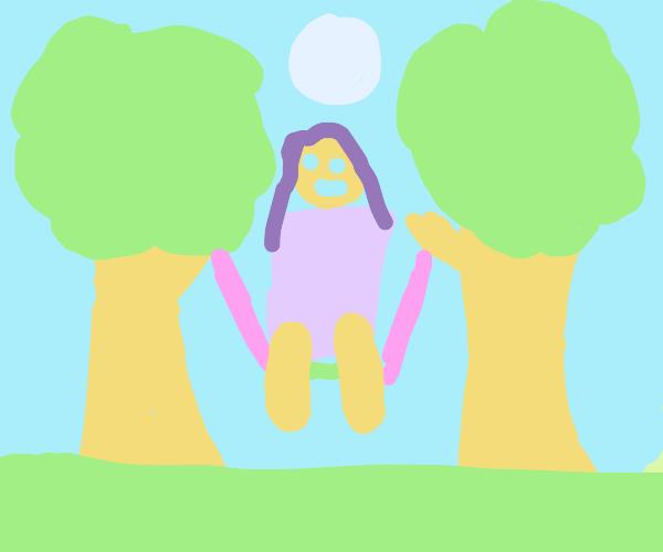 Autumn girl sitting on swing under the moon