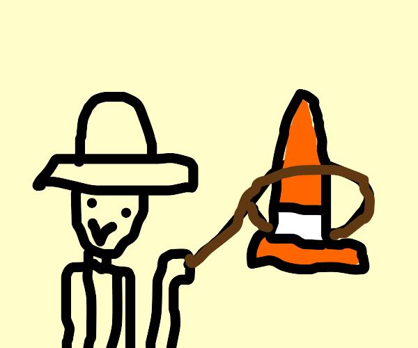 Cowboy lassos a traffic cone
