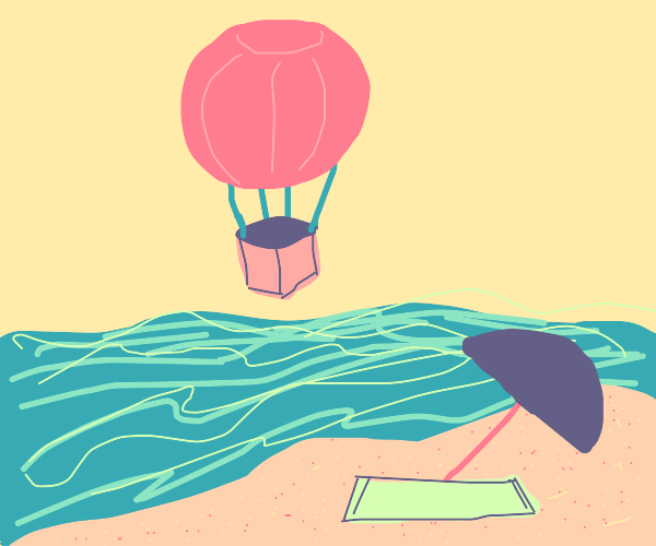 Hot air balloon flies over beach