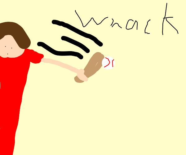 Man swings baseball bat