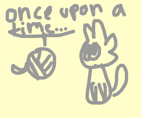 Yarn tells cute kitten a story.