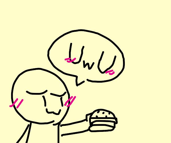 Guy blushes while holding burger