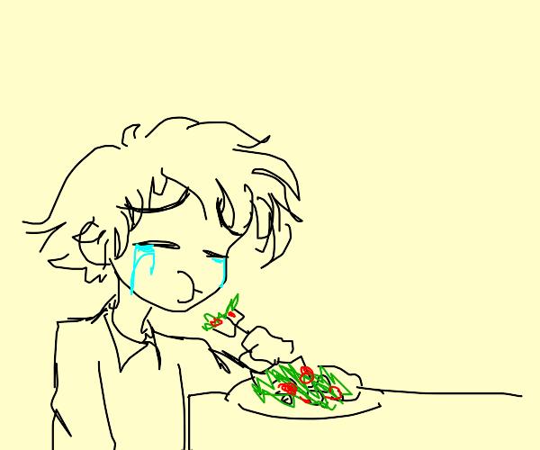 sad man eats salad