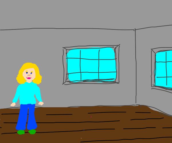 Blonde girl is in gray room