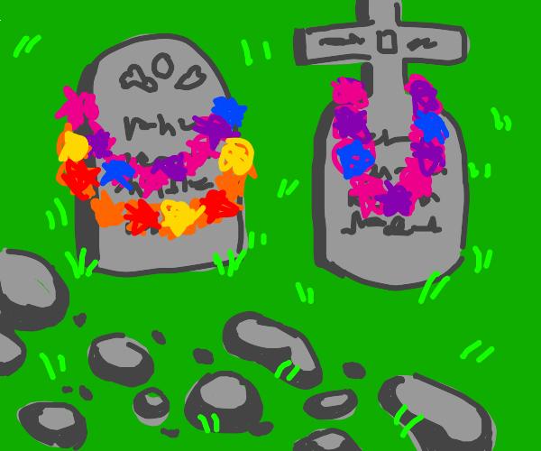 flower necklaces around gravestones