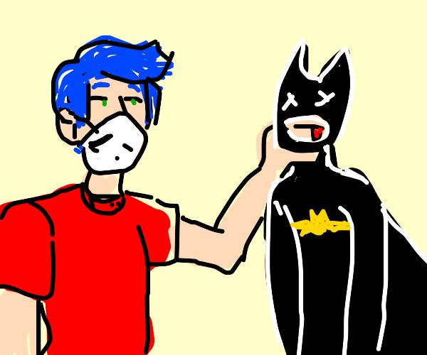 Masked guy killing batman