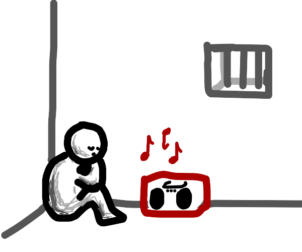 A sad guy listening to music in prison
