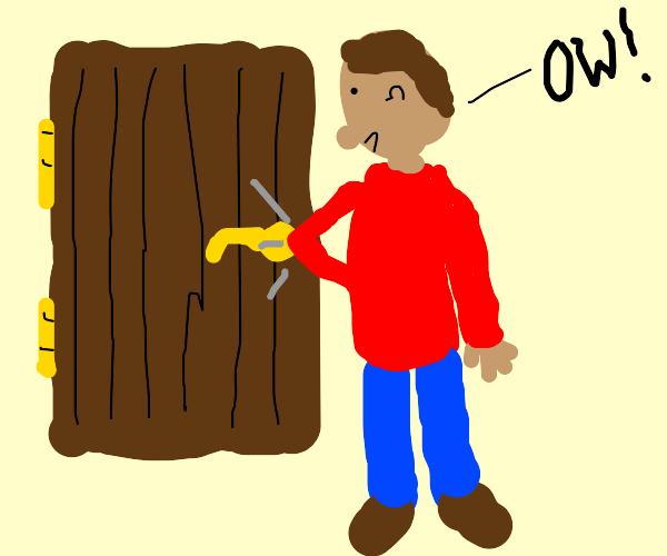 dude hits his elbow on door handle