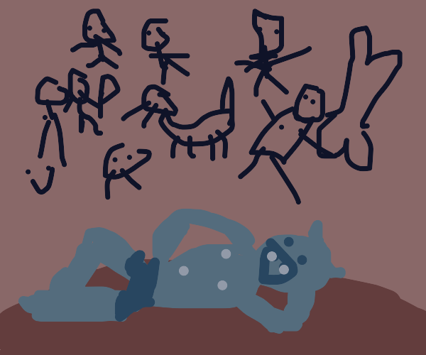 Gremlin poses lying down in front of cave art