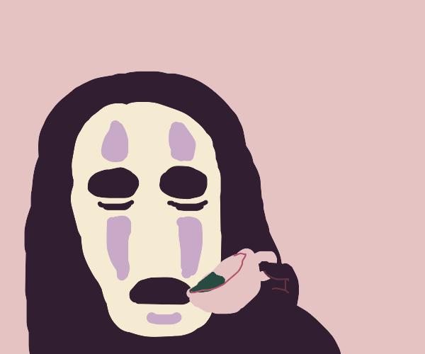 No Face sipping tea