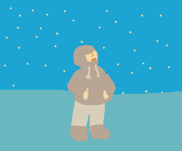 In a hoodie staring at the night sky