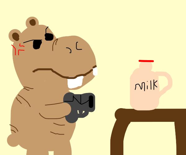 Green hippo man shoots choccy milk with gun