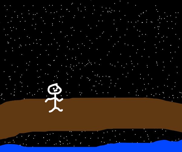 person walking on the bridge at night