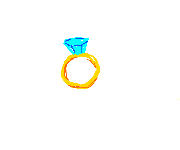 gold ring with a diamond on the top