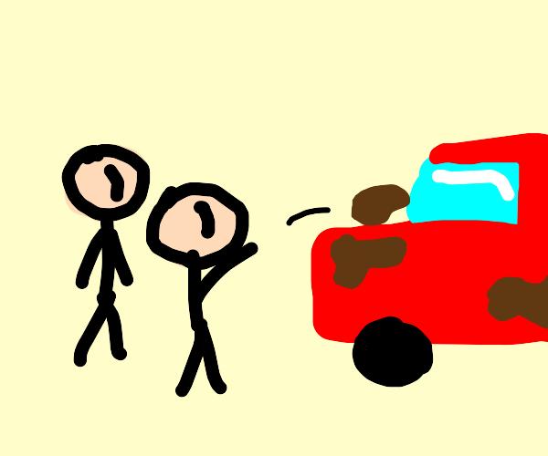 Kids throwing mud at a car