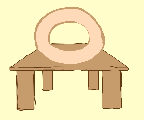 giant donut on table with donut slab