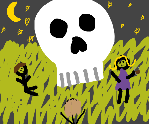 people hanging out at a giant skull