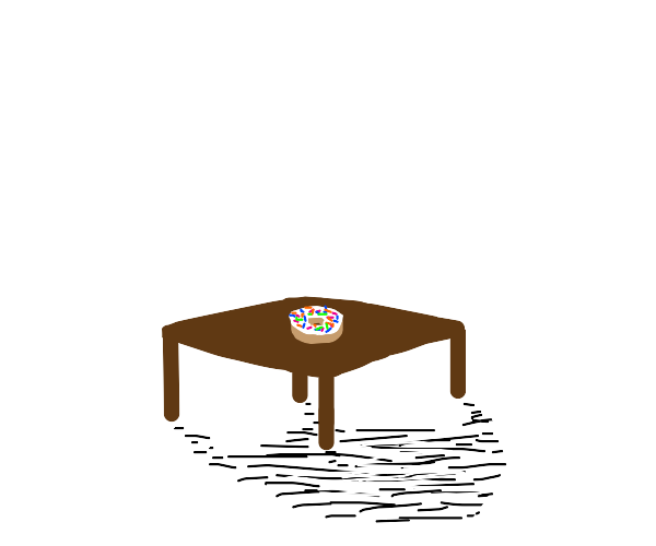 A table with a donut on it