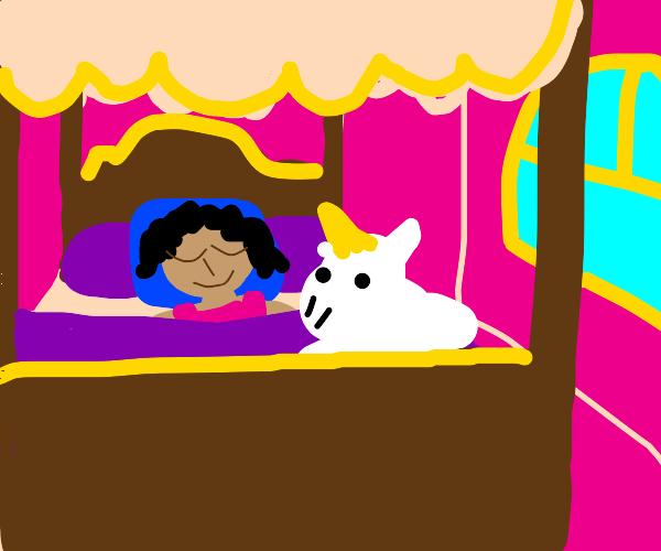 little girl sleeping in a fancy bed