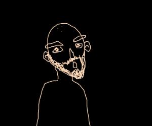 bald man in dark room