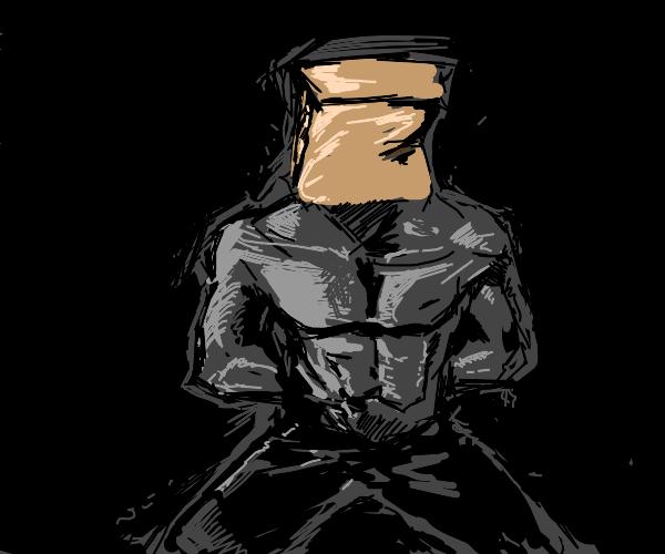 Shirtless man kneels w/ paper bag on his head