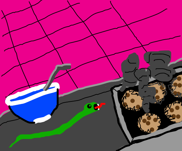 snake sits next to giant burnt cookie