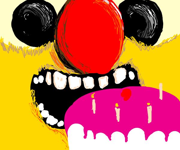 Creepy yellow Elmo looks at birthday cake