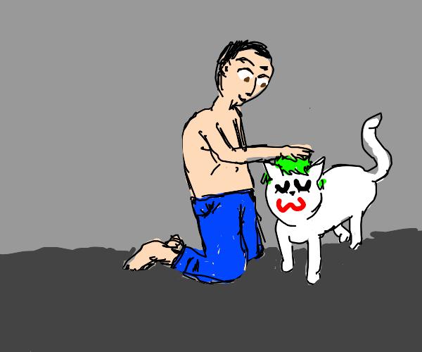 Man with brown eyes petting cat joker