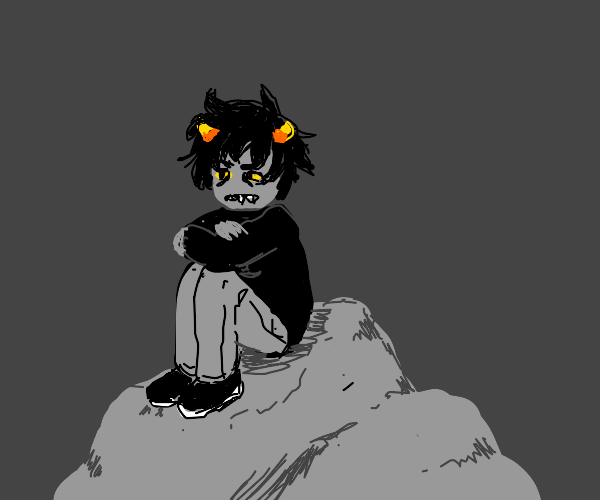Grey guy w/candy corn in hair sits on rock