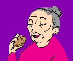 Old lady about to eat a cookie