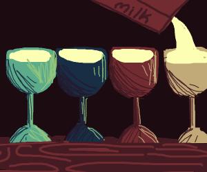 four diffrent colour glasses with milk