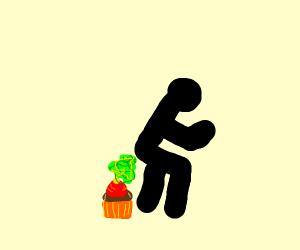 Black stickman farting on cupcake
