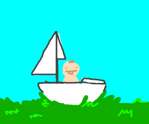 Baby on a boat that's on the grass