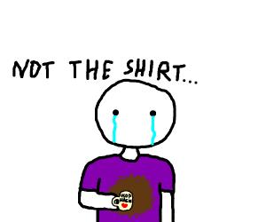 man is sad and has coffee on his shirt